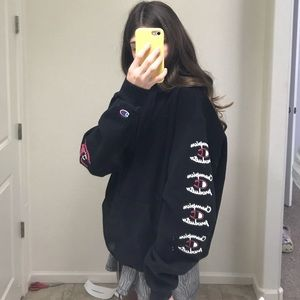 Champion black hoodie with logos on the arms/hood